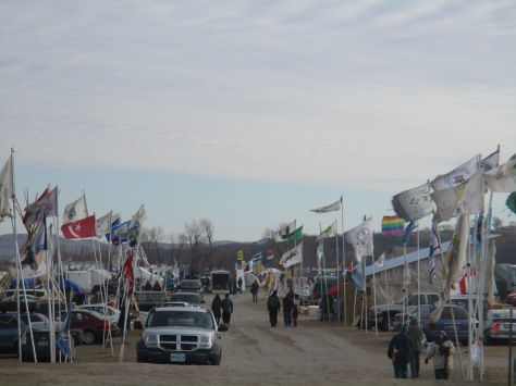 Driving into camp, flags of many nations