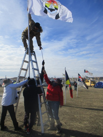 the group I was honored to accompany to Stand Rock hanging their flag